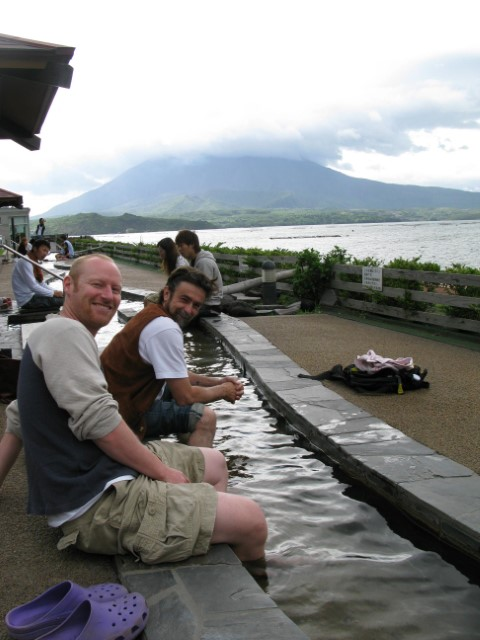 Foot spa with Sakurajima volcano smoking in the background